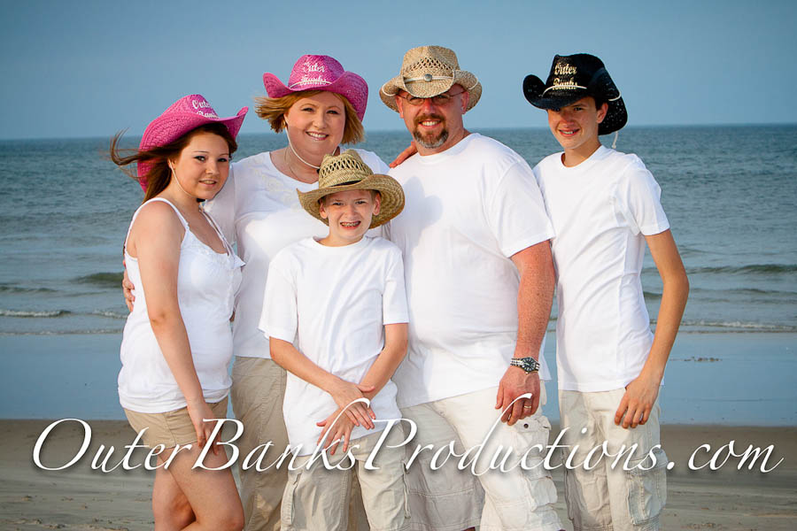 Family portrait photo with cowboy hats.