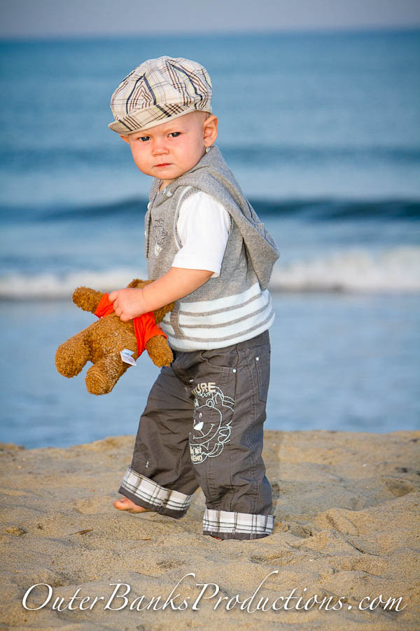 Child portrait with hat, vest and teddy bear.